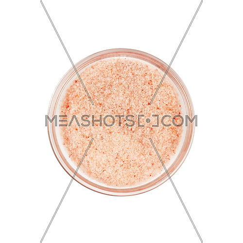 Close up one glass bowl saltcellar full of small crystals pink Himalayan salt isolated on white background, elevated top view, directly above