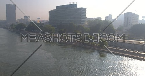Reveal shot Drone for Nile Ritz Carlton Hotel across Kasr Al Nile Bridge in Cairo Downtown at Day