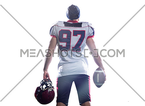 rear view of young confident American football player isolated on white background