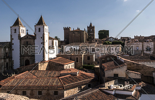 Caceres, Spain - july 13, 2018: Panoramic view of the Old Town, Santa Maria's Cathedral, romantic style of transition to Gothic, with some Renaissance elements, placed in the square of Santa Maria, Caceres, Spain