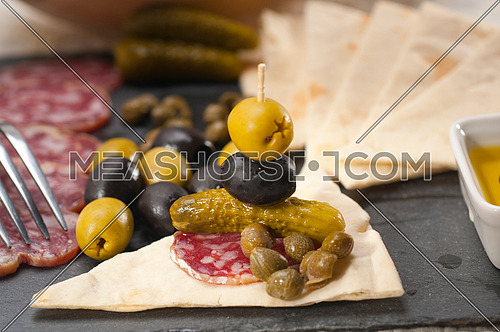 fresh cold cut platter with pita bread and pickles antipasti