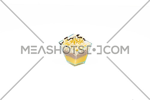 In the picture a cupcake with white choccolate,cream and custard in a plastic cup, isolated on white background.