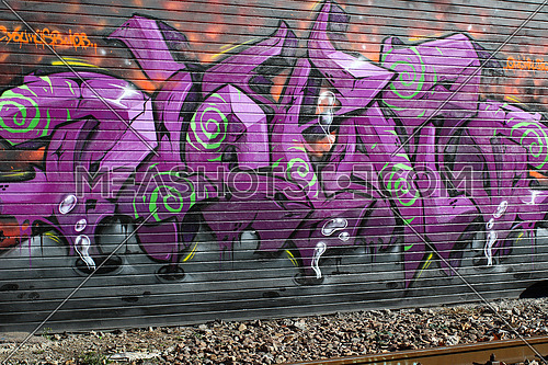 Cadenazzo, Switzerland, February 2016, Urban wall texture along railroad tracks keep popping up along railway tracks, graffiti art abstract background