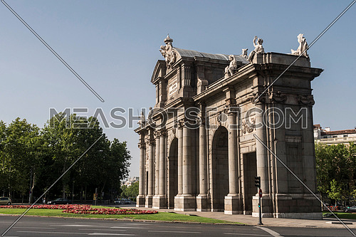 Madrid, Spain - August 4 2018:  Alcala Gate or Puerta de Alcala is a monument in the Plaza de la Independencia in Madrid, Spain