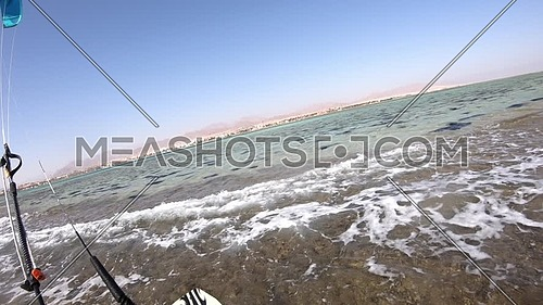 POV shot for Kite Surfer while surfing in Red Sea at day.