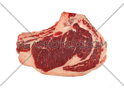 Close up one marbled raw ribeye beef steak with rib bone isolated on white background, elevated top view, directly above