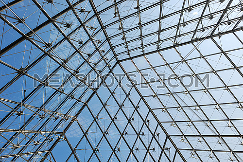 Metal roof top structure with glass construction background from Museum  du Louvre in paris france