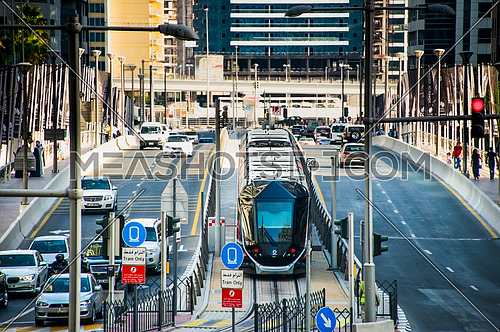 Dubai Tram crossing a bridge in Dubai Marina area  19 December 2015