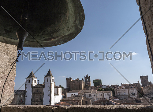 Caceres, Spain - july 13, 2018: Bell Tower of Co-cathedral, panoramic view of the ancient city of Caceres, placed in the square of Santa Maria, Caceres, Spain