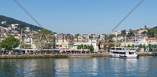 Istanbul, Turkey - April 27, 2017: View of Heybeliada island from the sea with summer houses. the island is the second largest one of four islands named Princes' Islands in the Sea of Marmara, near Istanbul, Turkey
