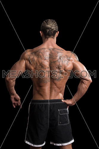 Back Rear View Tattooed Male On Isolated Black Background