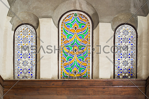 Three adjacent arched stained glass windows in a historic mosque, cairo, Egypt