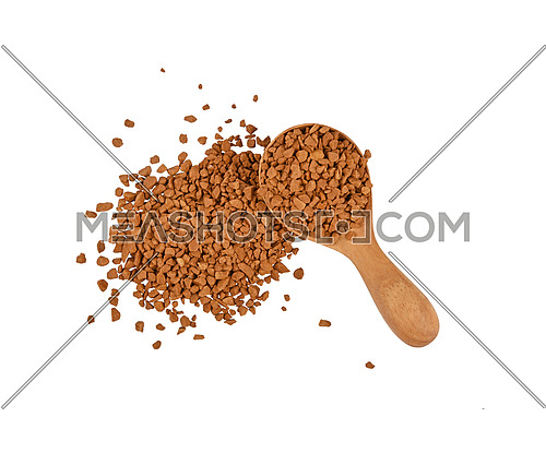 Close up heap and wooden scoop spoon full of freeze dried instant coffee granules isolated on white background, elevated top view, directly above