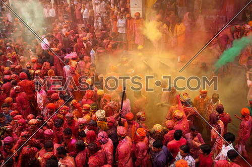 Large group of people celebrating Holi festival in Mathura, 22 March 2013 Uttar Pradesh. India.