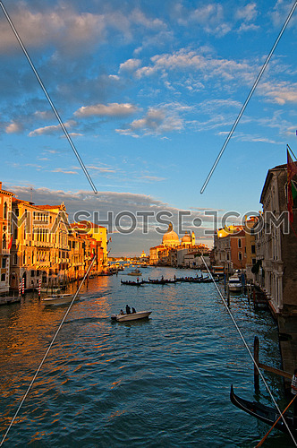 "Venice Italy grand canal view from the top of Accademia bridge with ""Madonna della Salute"" church on background at sunset"