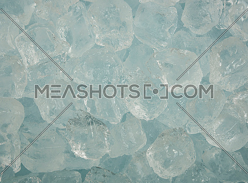 Close up background texture of clear ice cubes and rocks, directly above