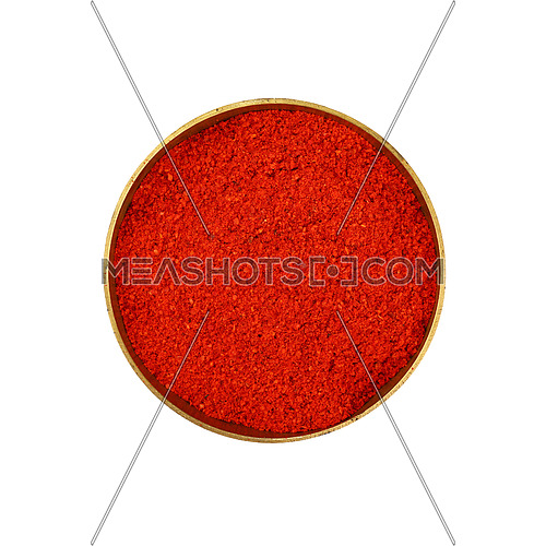 Close up one bronze metal bowl full of red chili pepper or paprika powder isolated on white background, elevated top view, directly above