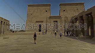Track in shot for the main entrance of Temple of Phila and tourists at Aswan - Egypt by day