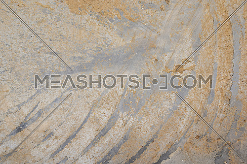Concrete wall or floor with dirty diagonal stripes strokes pattern on cement