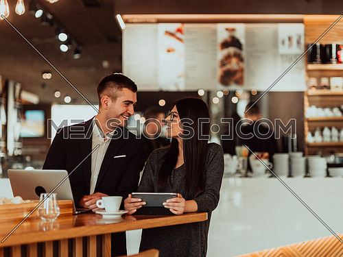 modern man and woman use modern devices, laptop, tablet, and smartphone and arrange new projects for the job
