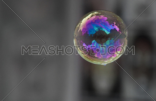 Bubble flying in the air - reflecting colors