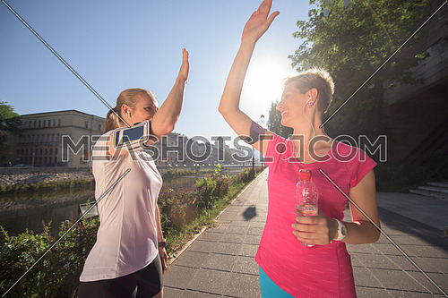 jogging friends couple congratulate and happy to finish their morning workout