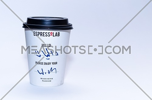 The take away paper cup of Espressolab -Espresso Lab with it's black cap and with a name written on it in Arabic which is ( Dalia / Dahlia ); December