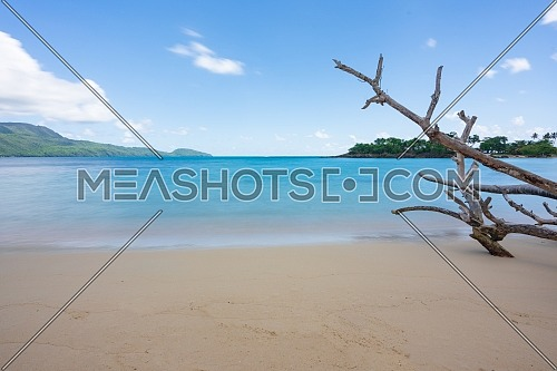 A view of exotic beach with sea, sand and blue sky,during the day on a public beach in Rincon Beach,Samana peninsula, Dominican Republic