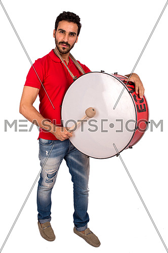 A young man encourages a football game using a drum