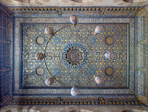 Ornate ceiling with blue and golden floral pattern decorations at Sultan Barquq mosque, Al Moez Street, Cairo, Egypt