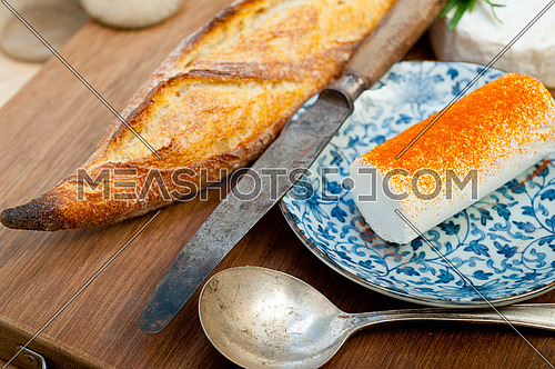 French cheese and fresh  baguette on a wood cutter