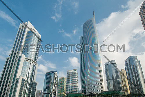 Tall skyscrapers in Dubai near water