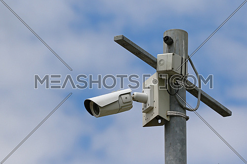 CCTV Video Cameras on pole against blue skies