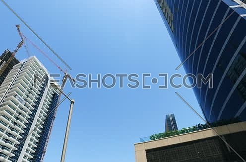 Low Angle shot Moving Around Towers at Dubai city