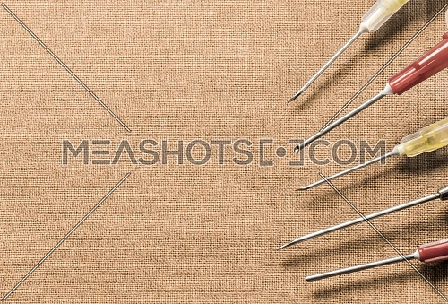Set Of Metallic Needles Of Different Size On Operations Table