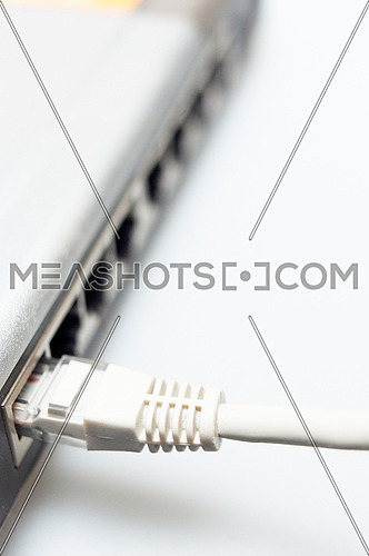 network hub switch with lan cable connected over white