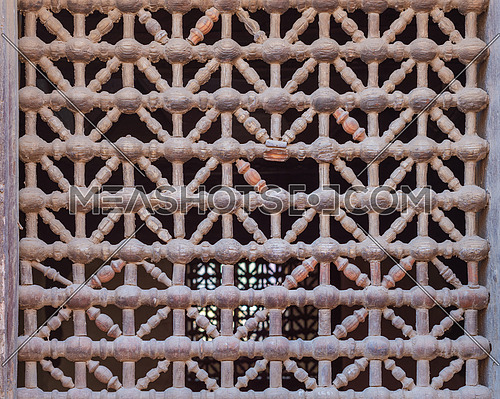 Old grunge weathered wooden fixed latticed window (Mashrabiya), Cairo, Egypt