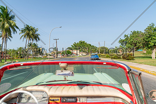 Cuba Varadero, inside an old vintage classic american car, view of cityscape sunny day.