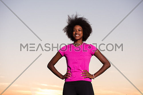 portrait of a young African American girl to run beautiful summer evening on city streets