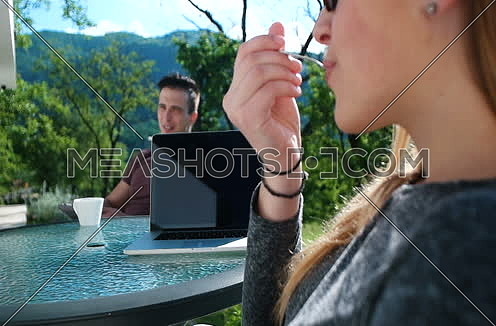 Couple drinking coffee on terrace of luxuary villa