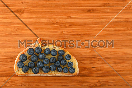 Better than caviar - cutting board with sandwich of mellow blueberries on slice of wheat bread