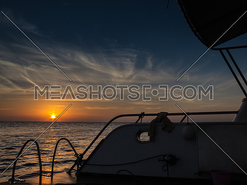sunset from a boat in the middle of the sea