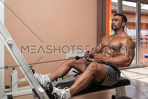 Mexican Bodybuilder Doing Heavy Weight Exercise For Back