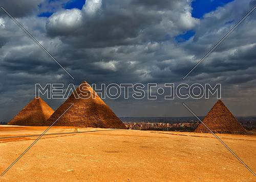 A cloudy gloomy sky over the pyramids if giza Egypt