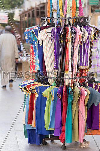 Clothes on a stand in outdoor market