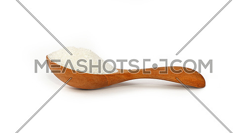 Close up one wooden scoop spoon full of white sugar isolated on white background, low angle side view