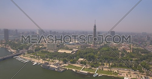 Pedestal shot Drone for Cairo Tower showing The River Nile,Traffic and Bridges in Cairo Downtown at Day