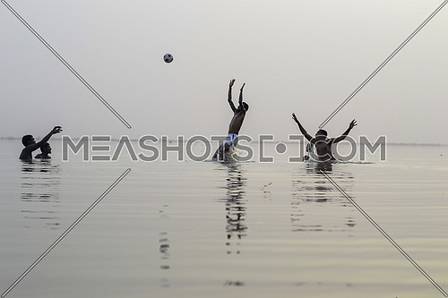 kids playing with a ball in the river nile in khartoum, Sudan