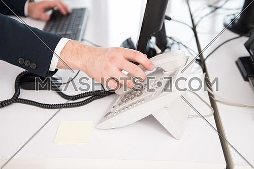 Businessman Pick Up Or Hangs Up The Phone In The Office