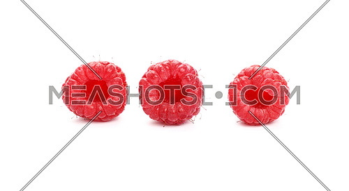 Three fresh red ripe mellow raspberry berries isolated on white background, detail close up, low angle view